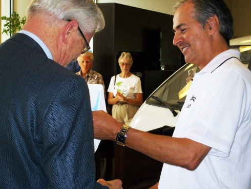 Mayor Ron Loveridge accepts keys to one of the new electric vehicles purchased from Ramon Alvarez, owner of Alvarez ZAP.